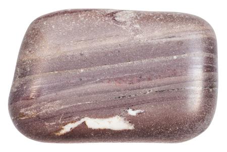 macro shooting of specimen of natural mineral - tumbled Argillite stone isolated on white background Stock Photo