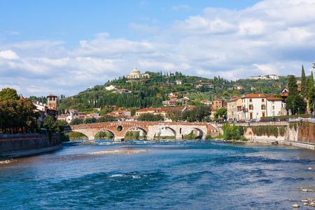 pons: travel to Italy - view of Ponte Pietra Roman arch bridge (Stone Bridge, Pons Marmoreus) crossing the Adige River in Verona,