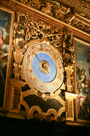 VENICE, ITALY - OCTOBER 14, 2016: interior of Doges Palace (Palazzo Ducale) - wall with clock. Doge Palace was built in Venetian Gothic style, and one of the main landmarks of the city of Venice.