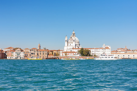 délivrance: VENICE, ITALY - OCTOBER 12, 2016: view of Basilica Santa Maria della Salute from San Marco basin in Venice. The church was Built in honor of the citys deliverance from the plague in 1630-1631 years Éditoriale