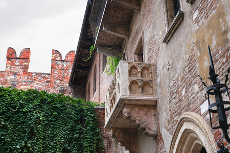 juliets: VERONA, ITALY - OCTOBER 10, 2016 - balcony of Juliets house in Verona city. Juliet's house (Casa di Giulietta) is one of the main tourist attractions of Verona