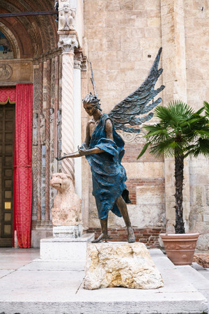consecrated: VERONA, ITALY - OCTOBER 10, 2016 - angel statue near west front entrance of Verona Cathedral (Cattedrale Santa Maria Matricolare, Duomo di Verona). The cathedral was consecrated on September 13, 1187 Editorial