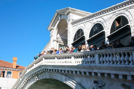 rialto: VENICE, ITALY - OCTOBER 12, 2016: tourists on Rialto Bridge (Ponte di Rialto) in Venice. It is the oldest bridge across Grand Canal.