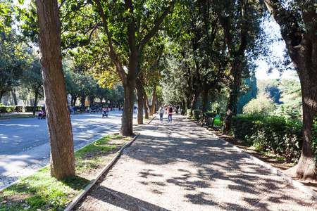villa borghese: travel to Italy - people in public urban park of Villa Borghese gardens in Rome city in autumn