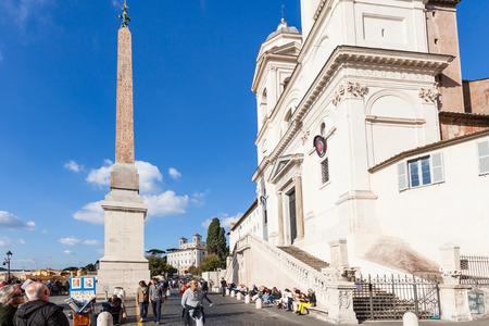 trinita: ROME, ITALY - NOVEMBER 1, 2016: people near church of Santissima Trinita dei Monti in Rome. Trinita dei Monti is best known for its position above Spanish Steps which lead down to the Piazza di Spagna Editorial