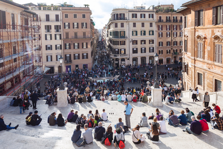 spanish steps: ROME, ITALY - NOVEMBER 1, 2016: people on Spanish Steps in Rome city. Spanish Steps are stairway in Rome, climbing a steep slope between the Piazza di Spagna at the base and Piazza Trinita dei Monti