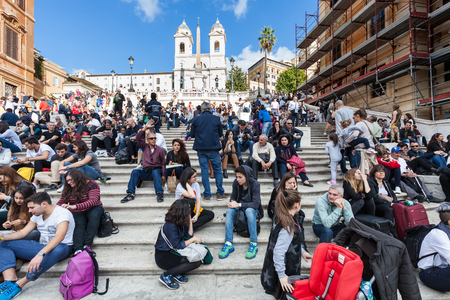 spanish steps: ROME, ITALY - NOVEMBER 1, 2016: crowd of tourists on Spanish Steps in Rome. Spanish Steps are stairway climbing a steep slope between the Piazza di Spagna at the base and Piazza Trinita dei Monti