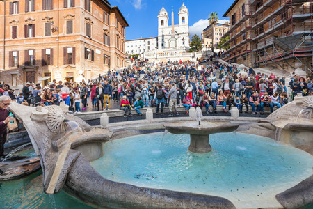 spanish steps: ROME, ITALY - NOVEMBER 1, 2016: Baroque-style Fontana della Barcaccia (Fountain of the Ugly Boat) and crowd of people on Spanish Steps on Piazza di Spagna in Rome city.
