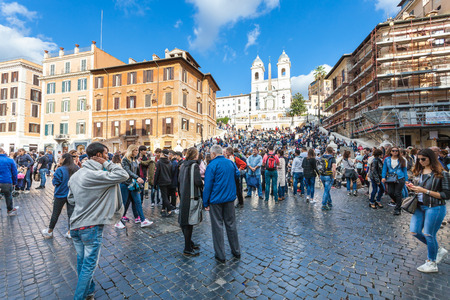 owes: ROME, ITALY - NOVEMBER 1, 2016: tourists on Piazza di Spagna, Spanish Steps and Church Trinita dei Monti. Piazza di Spagna is one of the most famous squares, it owes its name to the Palazzo di Spagna Editorial