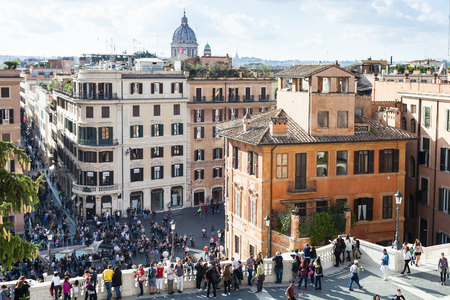 ROME, ITALY - NOVEMBER 1, 2016: view of people and Piazza di Spagna from piazza della Trinita dei Monti. Piazza di Spagna is one of the most famous squares, it owes its name to the Palazzo di Spagna