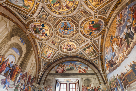 museum visit: VATICAN, ITALY - NOVEMBER 2, 2016: ceiling of Stanza della segnatura (Room of the Signatura) decorated by Raphaels frescoes in Raphael Rooms (Stanze di Raffaello) of Vatican museums.