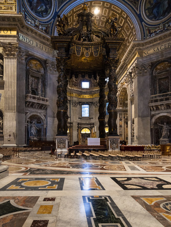 VATICAN, ITALY - NOVEMBER 2, 2016: baldachin (Berninis baldacchino) over the Papal Altar, made by Gian Lorenzo Bernini, in hall of Papal Basilica of St. Peter in the Vatican city Editorial