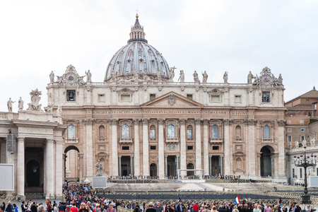 ROME, ITALY - NOVEMBER 2, 2016: people on piazza San Pietro near Basilica of St Peter. Basilica is the central and most prominent building of Vatican, the largest Christian church in the world Editorial
