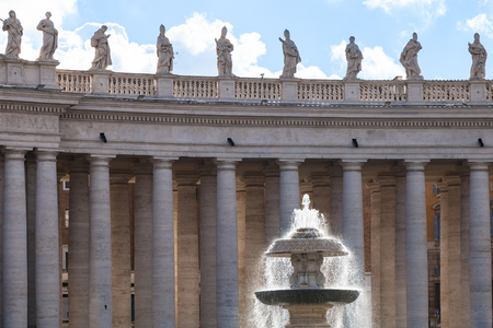 maderno: travel to Italy - Madernos fountain illuminated by sun and colonnade on piazza San Pietro in Vatican city