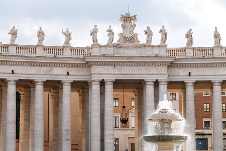 maderno: travel to Italy - Berninis colonnade and Madernos fountain on St Peters square in Vatican city Editorial