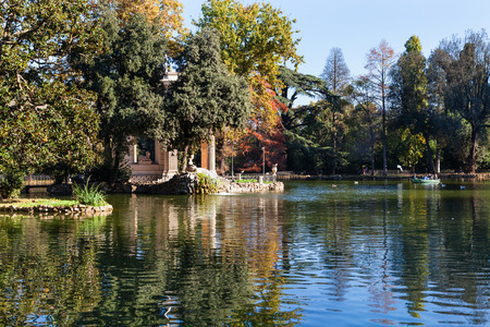 villa borghese: travel to Italy - pond and decorative Temple of Aesculapius in Villa Borghese public gardens in Rome city in autumn