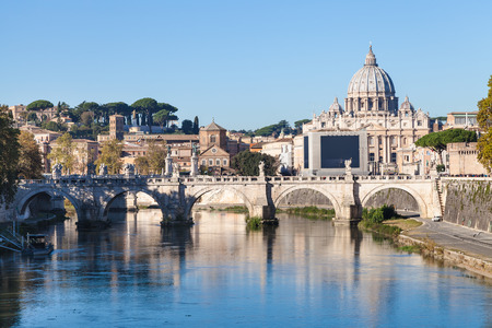 travel to Italy - Rome and Vatican city skyline with Basilica St. Peters, Tiber river, Ponte Sant Angelo (Bridge of Holy Angel) in autumn morning Stock Photo