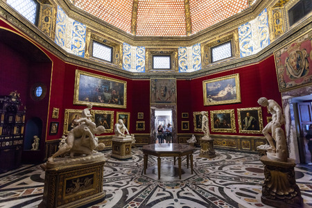 FLORENCE, ITALY - NOVEMBER 5, 2016: interior of Tribune room in Uffizi Gallery. The Uffizi is one of the oldest museums in Europe, its origin refers to 1560, when Vasari designed large palace