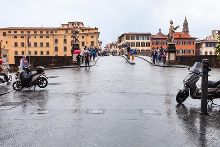 river arno: FLORENCE, ITALY - NOVEMBER 5, 2016: people on Ponte Santa Trinita over Arno river Florence city in autumn. The Ponte Santa Trinita is the oldest elliptic arch bridge in the world
