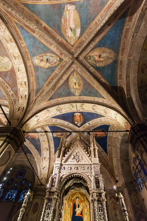FLORENCE, ITALY - NOVEMBER 5, 2016: ceiling of Orsanmichele church in Florence city. There is Andrea Orcagnas Gothic Tabernacle (1355-59) with older icon of the Madonna and Child by Bernardo Daddi