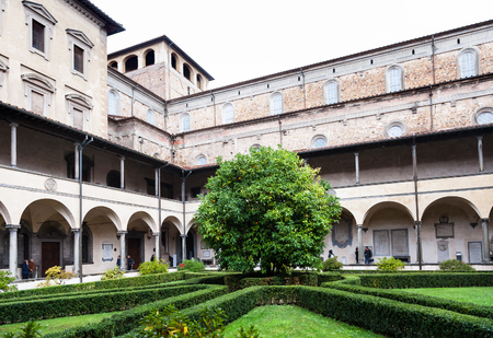 FLORENCE, ITALY - NOVEMBER 6, 2016: garden of Basilica di San Lorenzo (Basilica of St Lawrence) in rain. The Church is the burial place of all the principal members of the Medici family