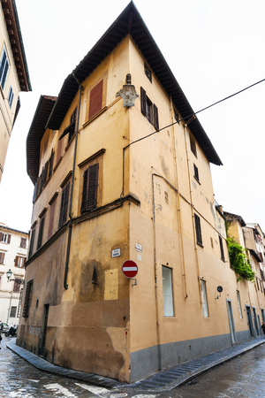 corner of house: FLORENCE, ITALY - NOVEMBER 6, 2016: corner house on via dell Anguillara in Florence. Via dell Anguillara is street of historic center of town, it runs from Piazza San Firenze to Piazza Santa Croce