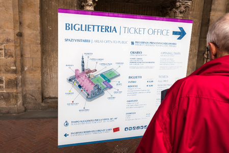 ticket office: FLORENCE, ITALY - NOVEMBER 6, 2016: visitor near entrance to ticket office of Basilica di Santa Croce (Basilica of the Holy Cross) in Florence city. The church is burial place of famous Italians.