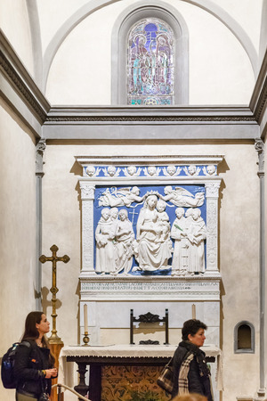 enthroned: FLORENCE, ITALY - NOVEMBER 6, 2016: people near altar in Medici chapel of Basilica di Santa Croce (Basilica of the Holy Cross) in Florence city. The church is burial place of famous Italians. Editorial