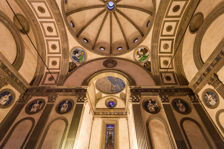 FLORENCE, ITALY - NOVEMBER 6, 2016: inside Pazzi chapel in Basilica di Santa Croce (Basilica of the Holy Cross) in Florence. The chapel was commissioned to Brunelleschi by Andrea de Pazzi in 1429 Editorial