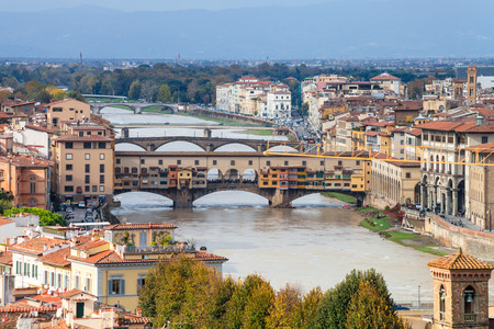 FLORENCE, ITALY - NOVEMBER 7, 2016: above view of Ponte Vecchio in Florence city from Piazzale Michelangelo. The Ponte Vecchio is medieval stone bridge noted for still having shops built along it