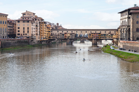 gloaming: travel to Italy - view of Ponte Vecchio (Old Bridge) over Arno River in Florence city in autmun evening