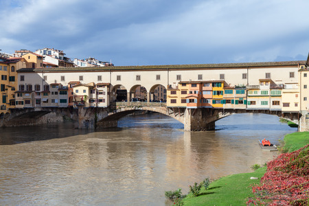 ponte vecchio: travel to Italy - view of Ponte Vecchio (Old Bridge) over Arno river in Florence city in sunny autumn day