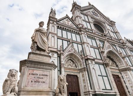 dante alighieri: travel to Italy - monument of Dante Alighieri and Basilica di Santa Croce (Basilica of the Holy Cross) in Florence city