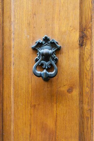 doorhandle: travel to Italy - bronze knocker on old wooden door in Florence city Stock Photo