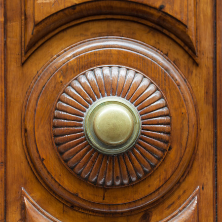 travel to Italy - brass ring knob on wooden door in Florence city