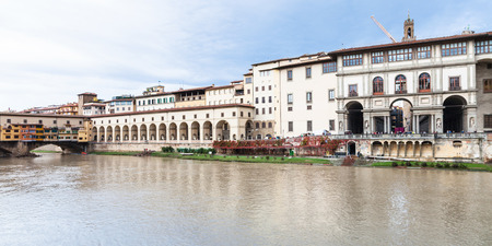 ponte vecchio: travel to Italy - panorama with ponte vecchio over Arno River, vasari corridor and Uffizi Gallery in Florence city
