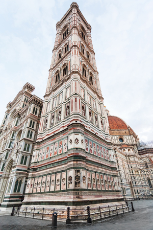 firenze: travel to Italy - Giottos Campanile and Florence Duomo Cathedral (Cattedrale Santa Maria del Fiore, Duomo di Firenze, Cathedral of Saint Mary of the Flowers) on Piazza del Duomo in morning