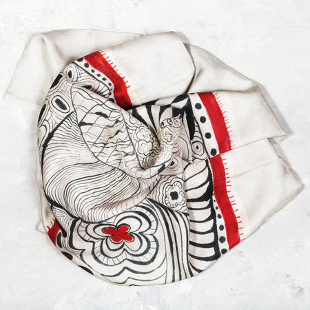 hand painted silk head scarf on concrete plate