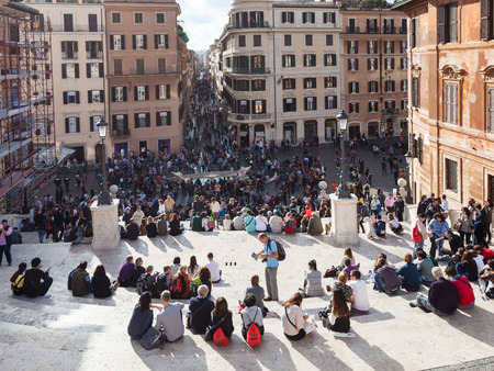 spanish steps: ROME, ITALY - NOVEMBER 1, 2016: tourist on Spanish Steps in Rome city. Spanish Steps are stairway in Rome, climbing a steep slope between the Piazza di Spagna at the base and Piazza Trinita dei Monti