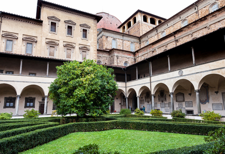 FLORENCE, ITALY - NOVEMBER 6, 2016: yard of Basilica di San Lorenzo (Basilica of St Lawrence) in rain. The Church is the burial place of all the principal members of the Medici family Editorial