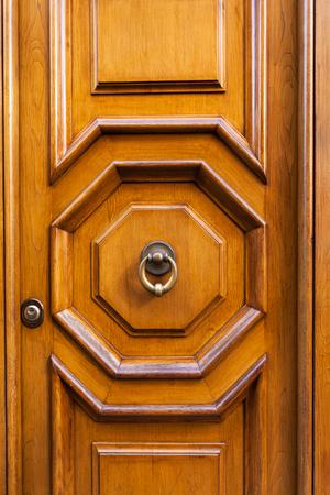 travel to Italy - wood door with brass ring door knocker in Rome city