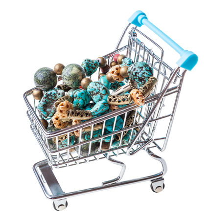 shopping trolley with necklace from gem stones isolated on white background Stock Photo