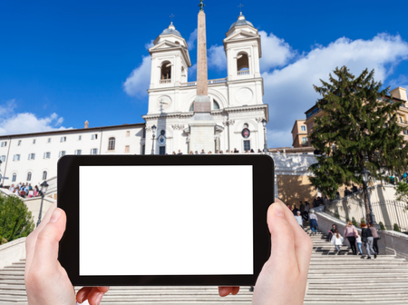 spanish steps: travel concept - tourist photographs Church Santissima Trinita dei Monti and Spanish Steps in Rome city on tablet with cut out screen with blank place for advertising in Italy