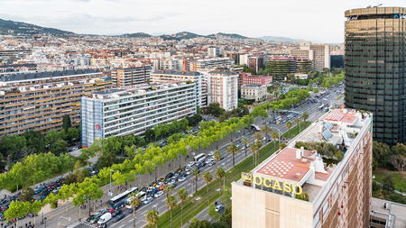 BARCELONA, SPAIN - APRIL 24, 2012: Above view of avenue Avinguda Diagonal in Barcelona city in spring evening. This is main street in city, it is about 50 meters wide and 11 kilometers long