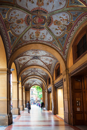 BOLOGNA, ITALY - OCTOBER 31, 2012: decorated medieval arcade on piazza Cavour in Bologna city. The painting of the arcade vault was completed by Gaetano Lodi between 1862 and 1865 Editorial