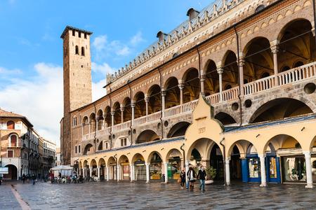 PADUA, ITALY - NOVEMBER 1, 2012: tourists near Palazzo della Ragione on Piazza delle Erbe in Padua city in autumn. The Palazzo was begun in 1172 and finished in 1219
