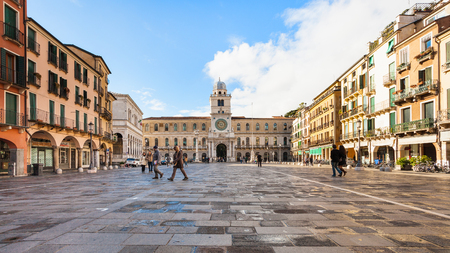 PADUA, ITALY - NOVEMBER 1, 2012: people on Piazza dei Signori and view of Palazzo del Capitanio in autumn in Padua city. The present facade of the palace was begun in 1599 and completed in 1605 Editorial