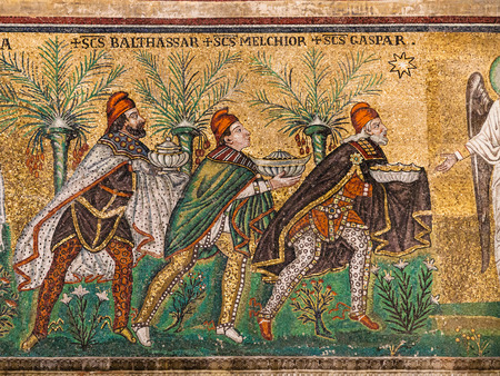 RAVENNA, ITALY - NOVEMBER 4, 2012: mosaic with three Magi of Catherdal Sant Apollinare Nuovo close up in Ravenna city. Cathedral was erected by Ostrogoth King Theodoric during 6th century