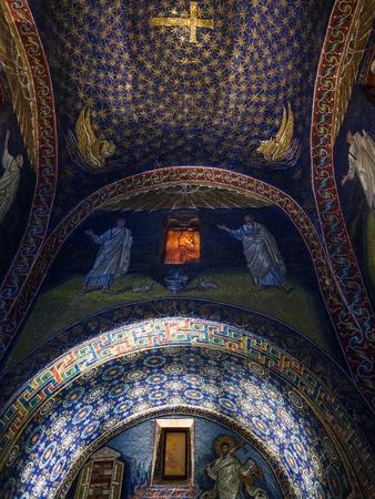 RAVENNA, ITALY - NOVEMBER 4, 2012: interior of Galla Placidia mausoleum in Ravenna city. Mausoleum was built between 425 and 433, this small mausoleum adopts a cruciform plan. Editorial