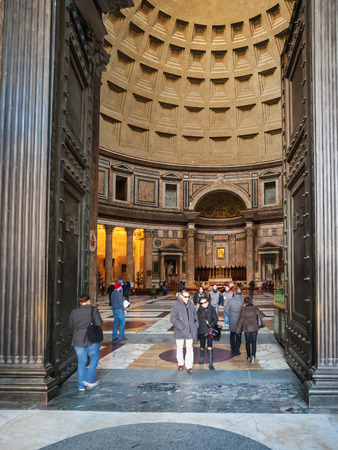 ROME, ITALY - DECEMBER 16, 2010: visitors in doors of pantheon in Rome city. The Pantheon is a former Roman temple, now a church, was built on site of an earlier temple commissioned by Marcus Agrippa